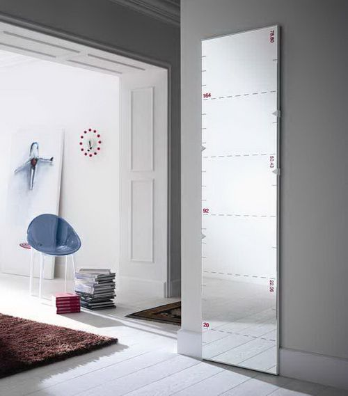 Vintage mirrors add taste in a house with large windows, wooden floors ...